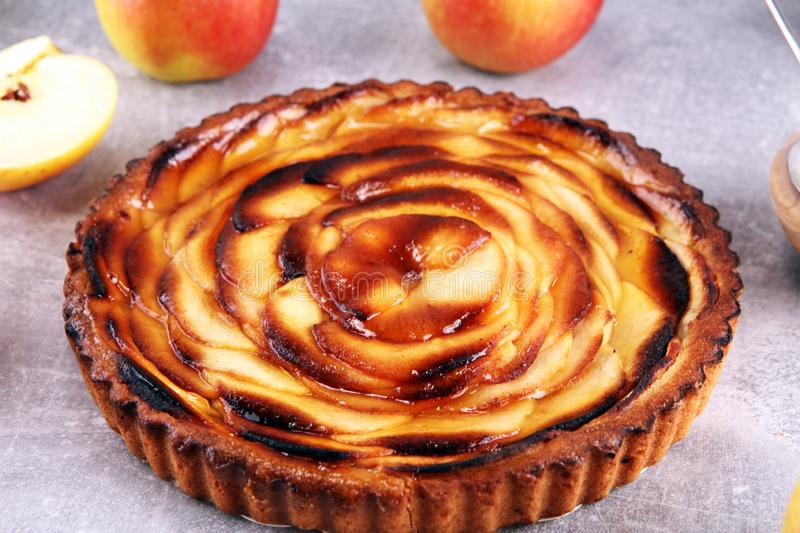 Apple tart. Gourmet traditional holiday apple pie sweet baked dessert food with cinnamon and apples on table. Apple tart. Gourmet traditional holiday apple pie royalty free stock photo
