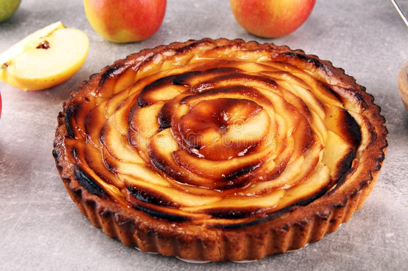 Apple tart. Gourmet traditional holiday apple pie sweet baked dessert food with cinnamon and apples on table. For dessert stock photo
