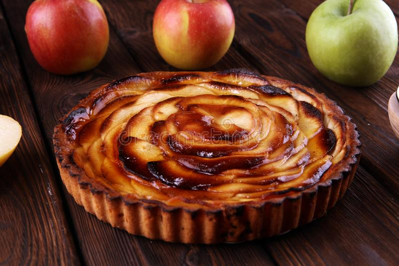 Apple tart. Gourmet traditional holiday apple pie sweet baked dessert food with cinnamon and apples on table. For des.sert stock image