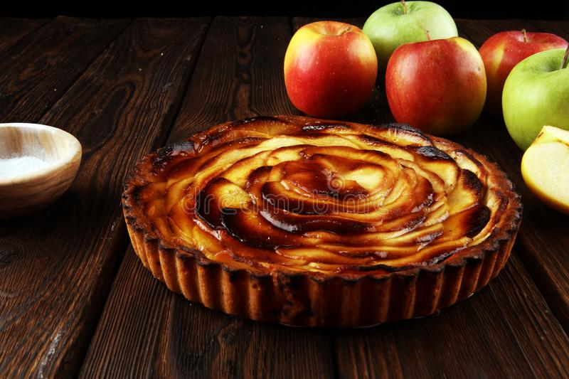 Apple tart. Gourmet traditional holiday apple pie sweet baked dessert food with cinnamon and apples on table. For d.essert stock image