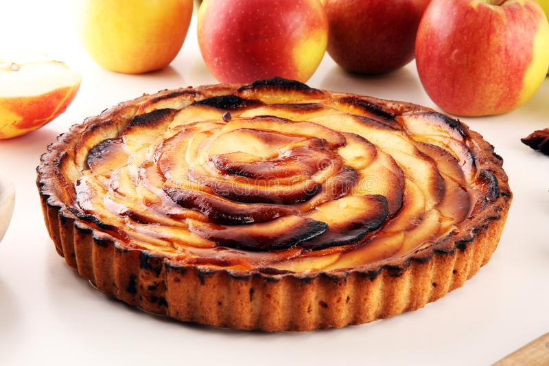 Apple tart. Gourmet traditional holiday apple pie sweet baked dessert food with cinnamon and apples on table. For dessert stock image