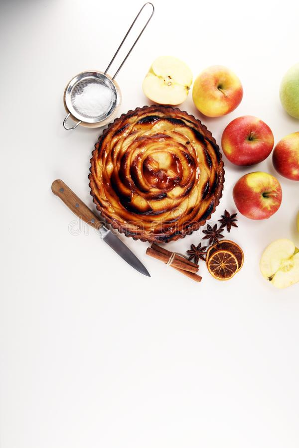 Apple tart. Gourmet traditional holiday apple pie sweet baked dessert food with cinnamon and apples on table. For dessert royalty free stock photos