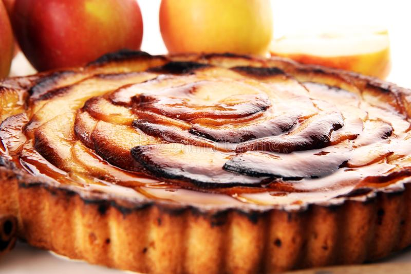 Apple tart. Gourmet traditional holiday apple pie sweet baked dessert food with cinnamon and apples on table. For .dessert stock image