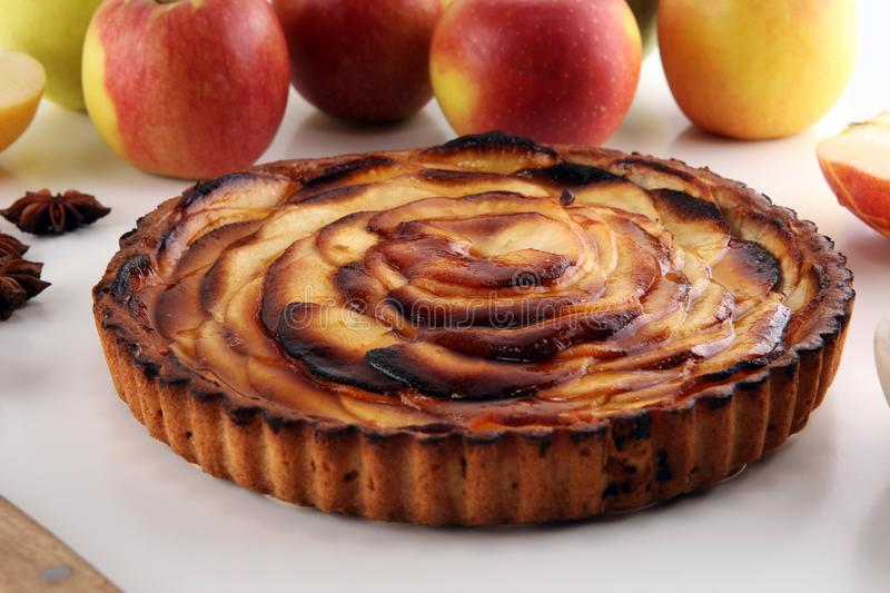 Apple tart. Gourmet traditional holiday apple pie sweet baked dessert food with cinnamon and apples on table. Apple tart. Gourmet traditional holiday apple pie royalty free stock image