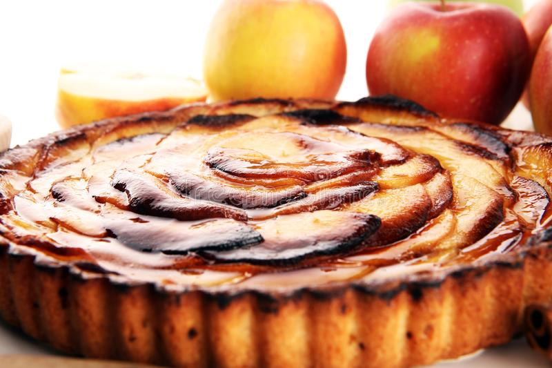 Apple tart. Gourmet traditional holiday apple pie sweet baked dessert food with cinnamon and apples on table. For d.essert stock photography