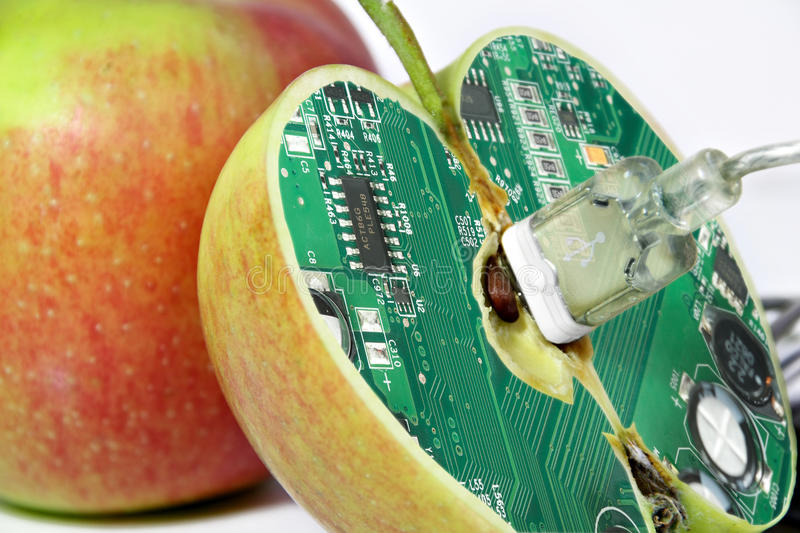Apple with technology core stock images