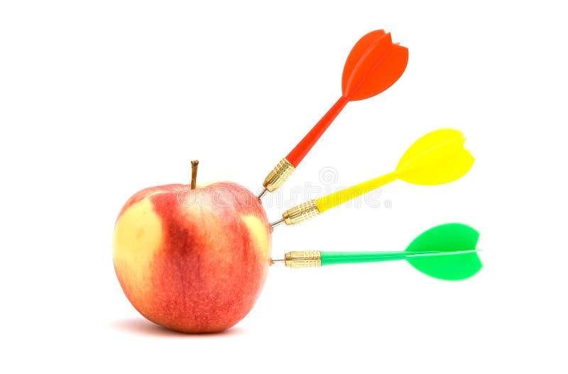 Apple with three darts royalty free stock image