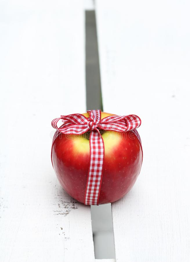 Download Apple Tied With A Gingham Bow Stock Image - Image: 83710527