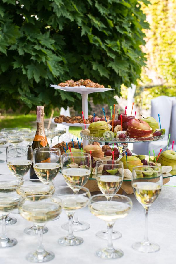 Apple on the tray. Before the party. Glasses with champagne and white wine before party in cafe stock photography