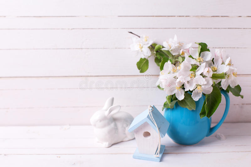 Apple tree flowers in pitcher, Easter rabbit and decorative bi royalty free stock photography