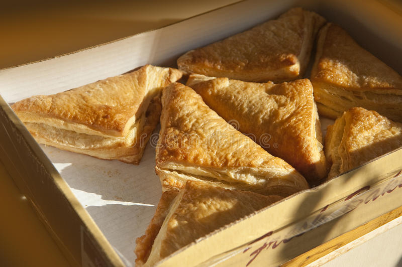 Apple turnovers. Fresh out of the box ready for breakfast stock photo
