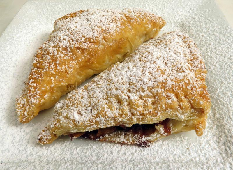 Apple Turnovers Topped With Powdered Sugar stock images