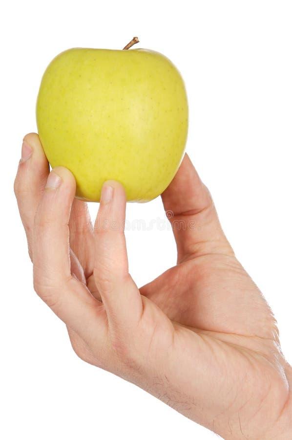 Apple in una mano fotografia stock