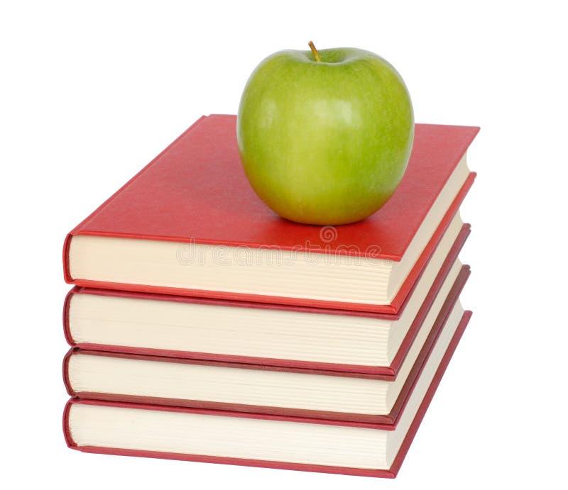 Apple und Bücher stockfoto