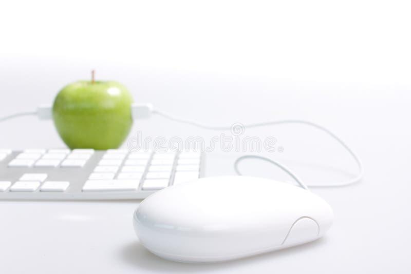 Apple und Computer lizenzfreies stockfoto