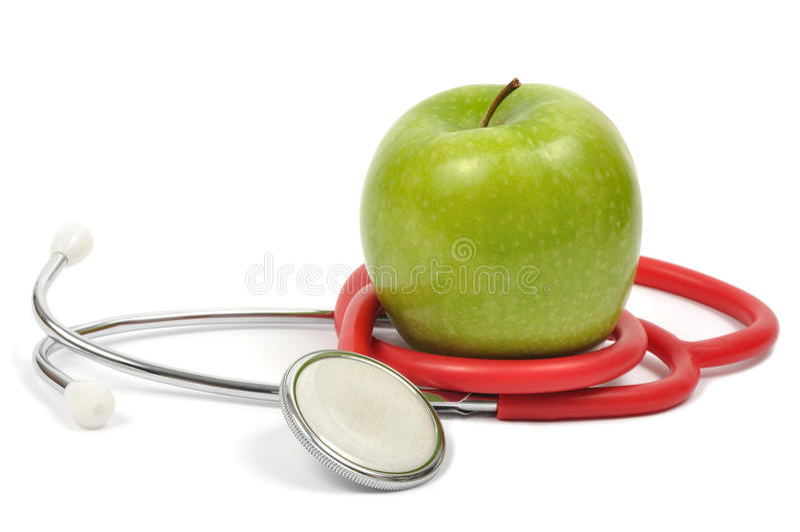 Apple und Stethoskop stockbild