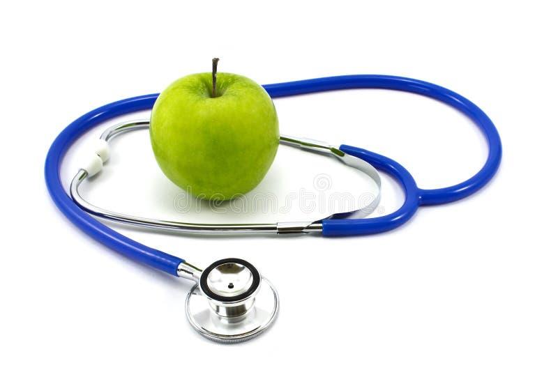 Apple und Stethoskop stockfotos