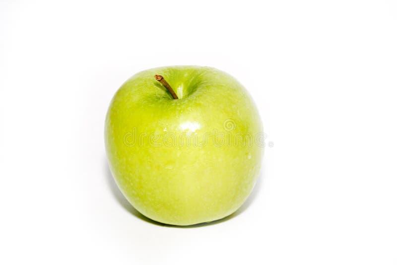 Apple verde su priorità bassa bianca immagine stock