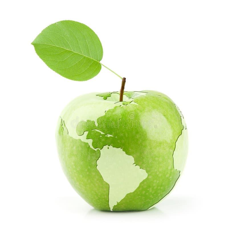 Apple vert avec la carte du monde photographie stock libre de droits