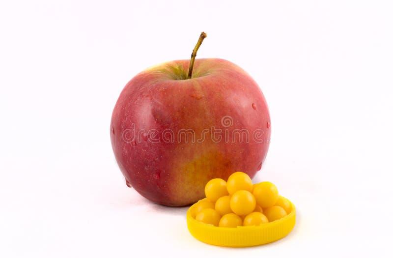 Apple and vitamins stock photo