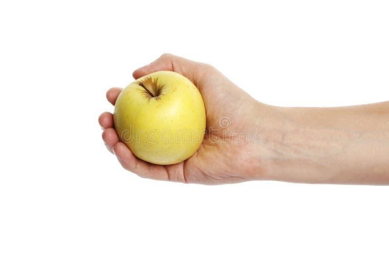 Apple w ręce odizolowywającej na białym tle zdjęcia stock