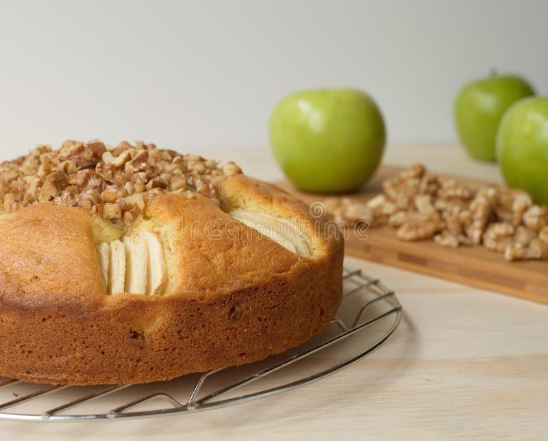 Apple and Walnut Dessert Cake, Cooking Apples and Walnut Pieces. stock image