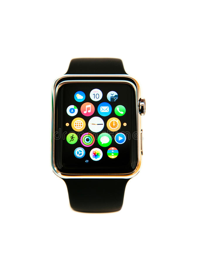 Apple Watch isolated on white. PARIS, FRANCE - APRIL 10, 2015: Apple Watch smartwatch the 38mm 18-Carat Yellow Gold Case with Bright Black Modern Buckle. Apple