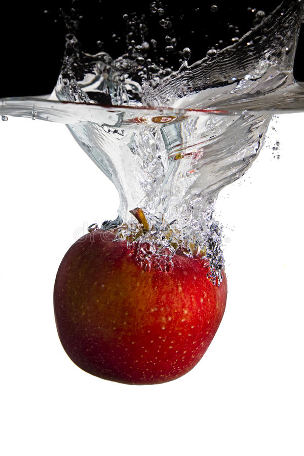 Apple in water stock photography