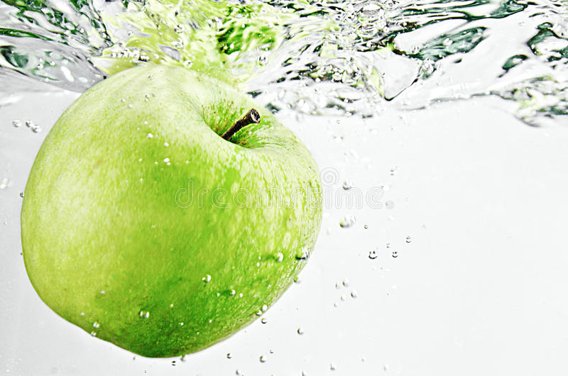 Apple in water stock image