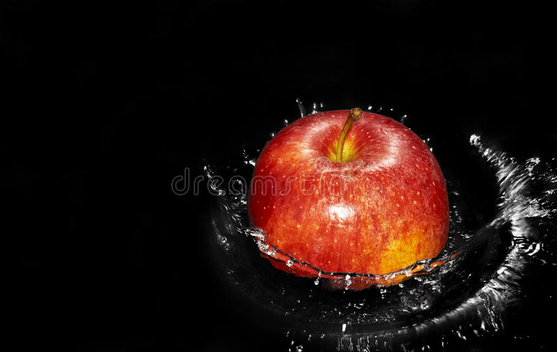 Apple In Water Splash Royalty Free Stock Photo