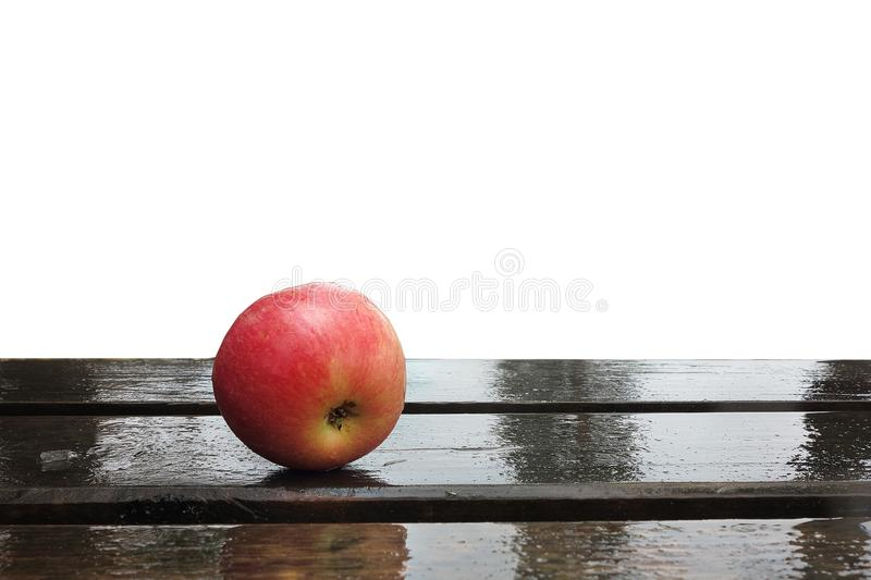 Apple on wet boards isolated. On white background royalty free stock photos