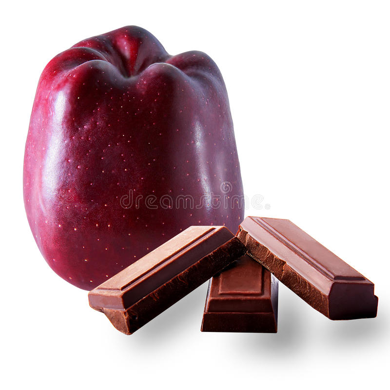 Apple whit noair chocolate. Apple and chocolate noir on the white background royalty free stock photo