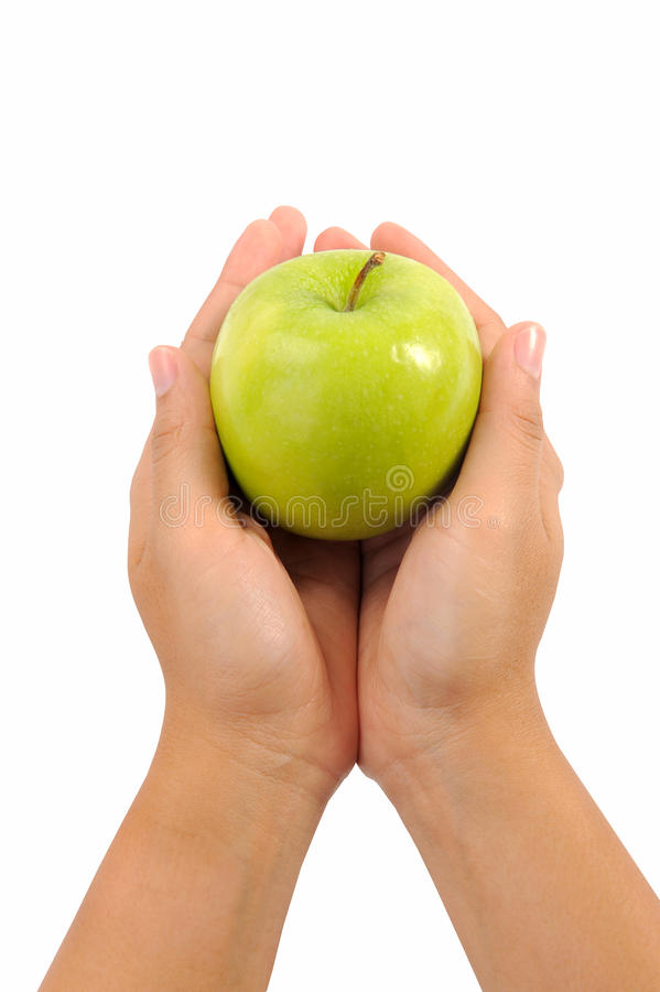 Apple in woman hands royalty free stock photos