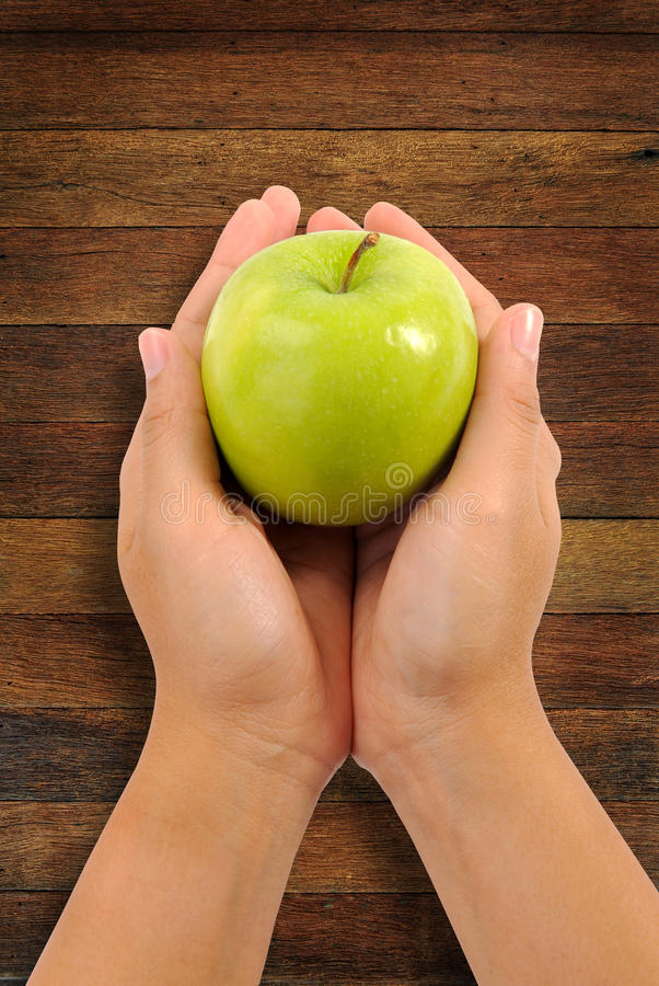 Apple in woman hands close up stock photos