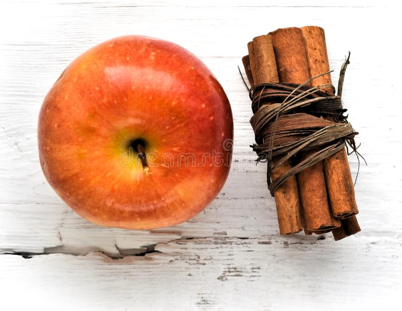 Apple on wooden table ingredient cinnamon sticks stock images