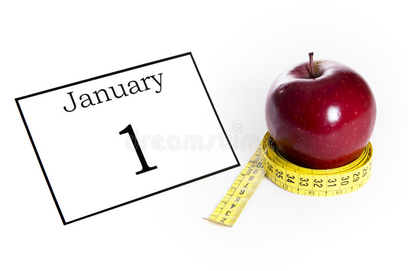Apple wrapped in tailor tape. In concept of Diet and Health stock photo