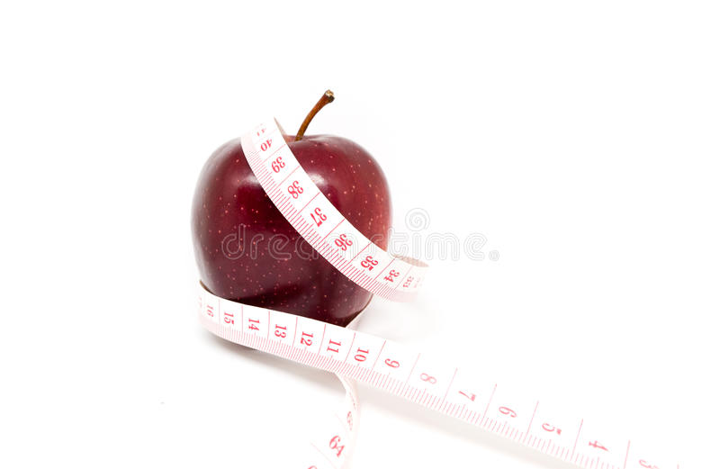 Apple. Wrapped in tailor tape in concept of Diet and Health stock image