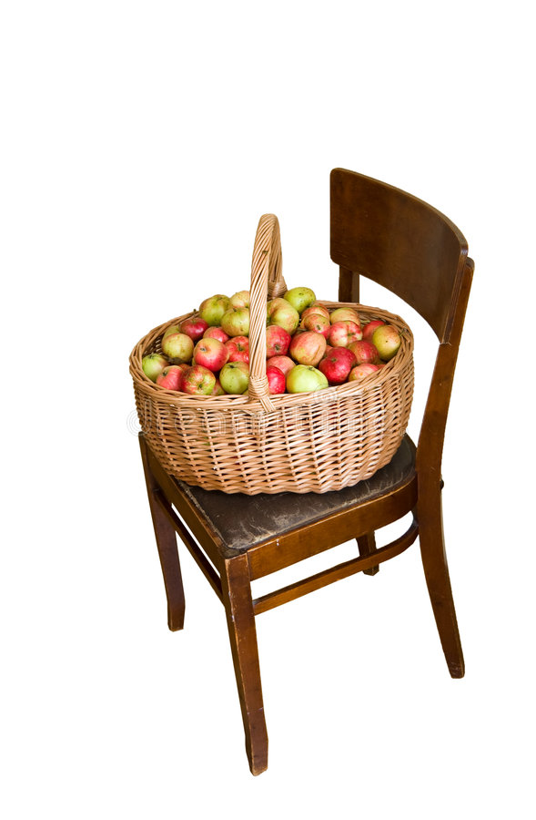 Apples in basket at chair stock photos