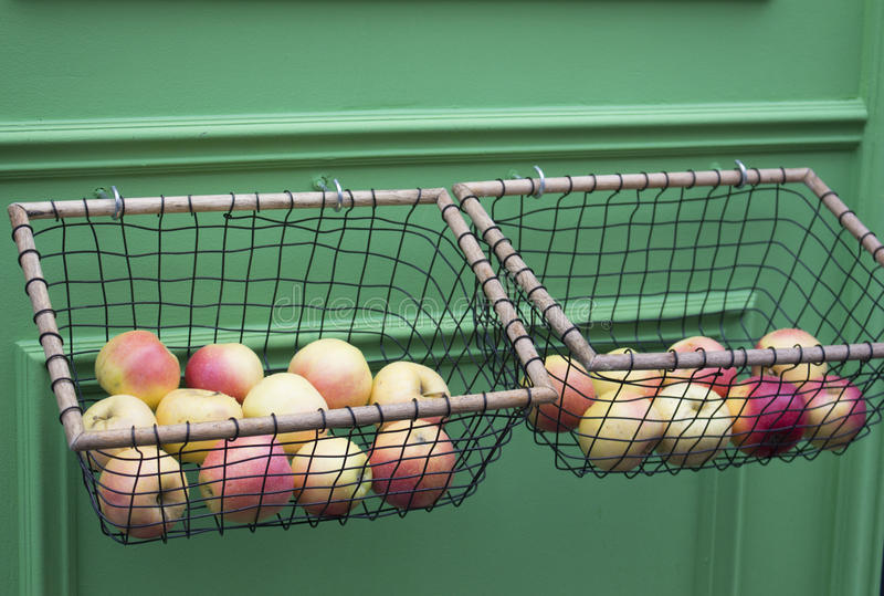 Apples in the baskets stock photos