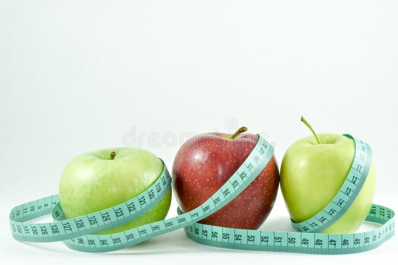 Apples and centimeter tape stock images