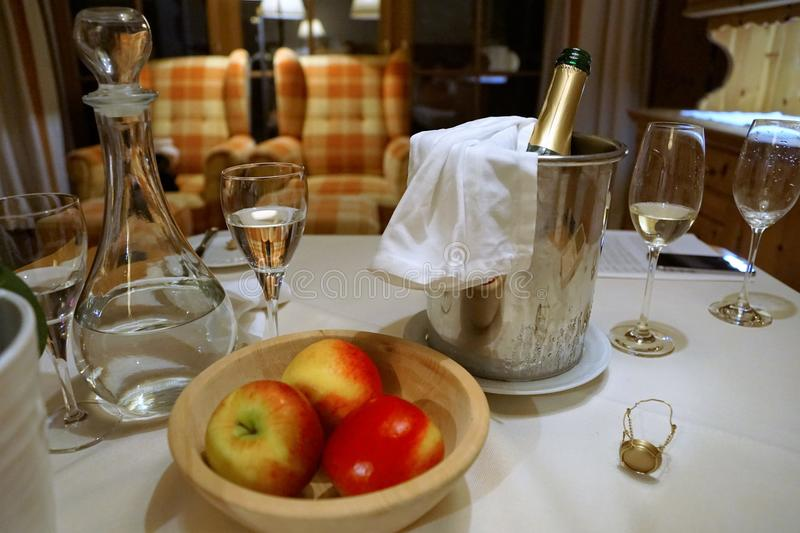 Apples and champagner. At a hotel in austria royalty free stock photo