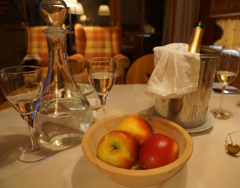 Apples and champagner. At a hotel in austria royalty free stock images