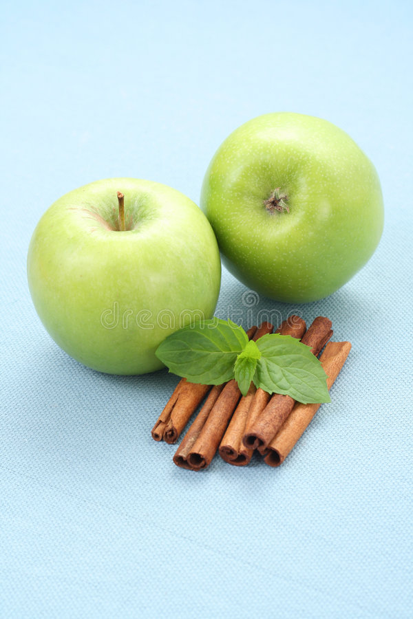 Apples and cinnamon stock photography