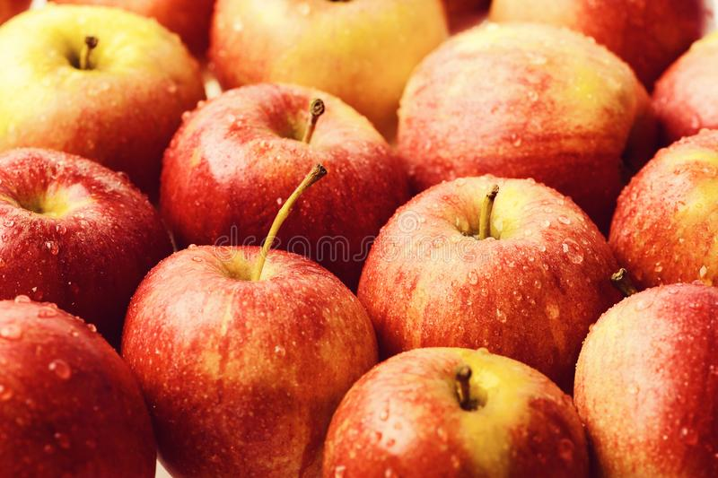 Apples. fresh raw lot of red apples, many organic fresh sweet fruit, wet apple background with water drops. Apples. fresh raw lot of red apples, many organic stock image