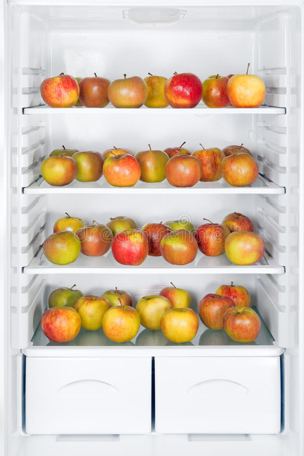 Apples in fridge stock photography