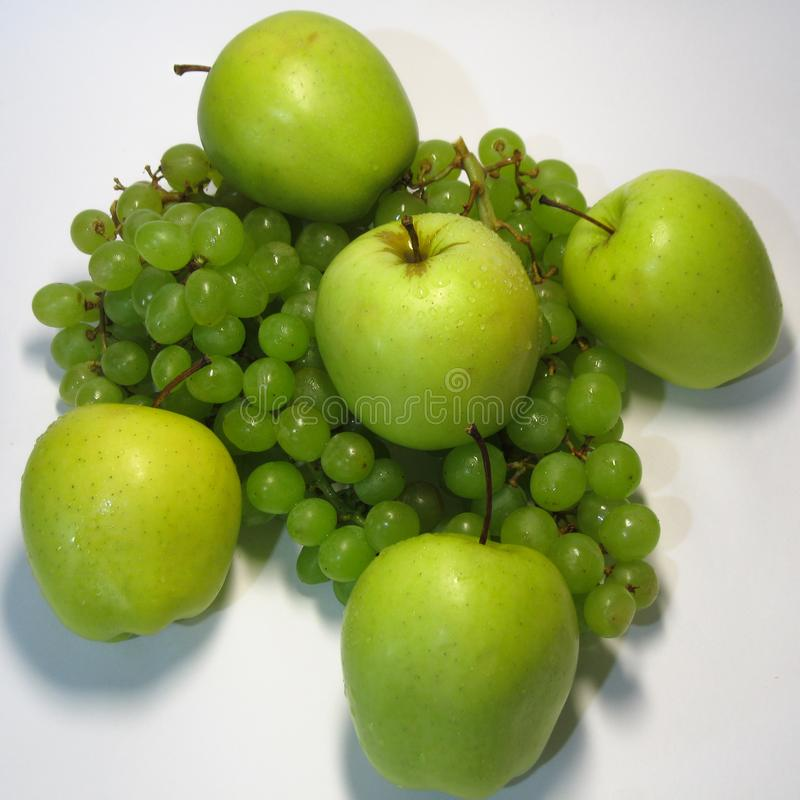 Apples and grapes - beauty and benefit, taste and health, an inexhaustible source of vitamins. stock photo