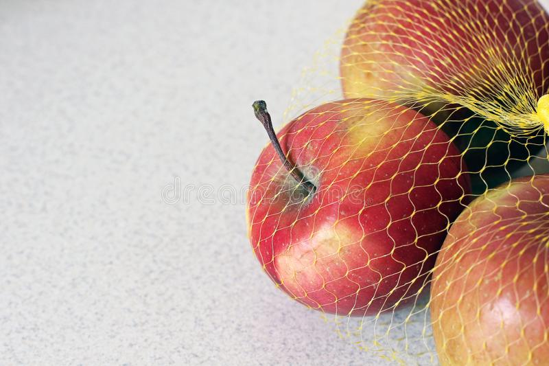 Apples in a grid on a white background.  royalty free stock image