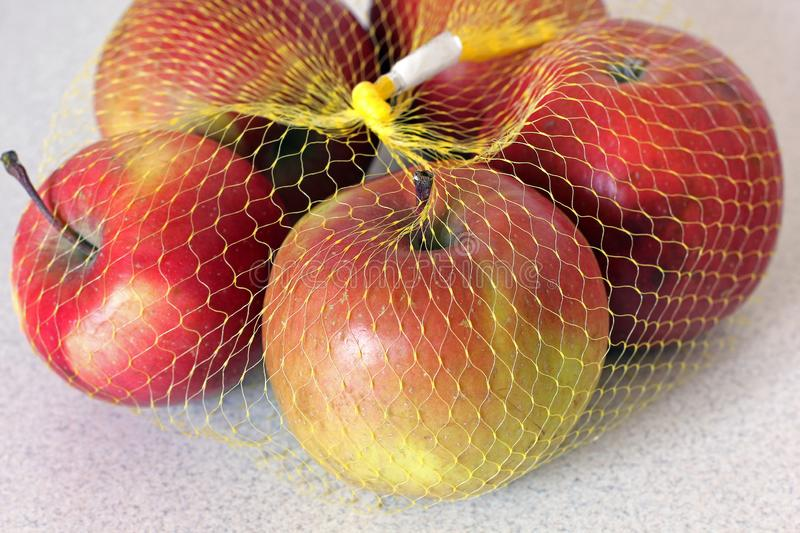 Apples in a grid on a white background.  royalty free stock photos