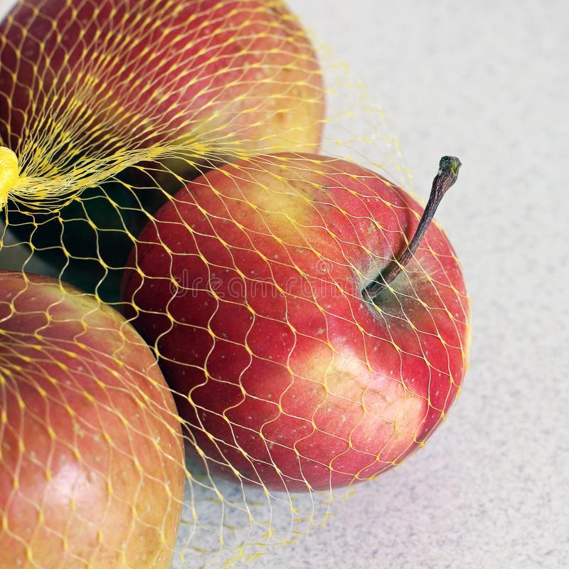 Apples in a grid on a white background.  stock photos