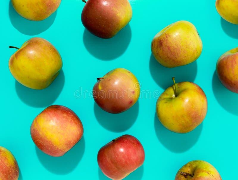 Apples with hard shadow on aqua background, flat lay image.  stock photo